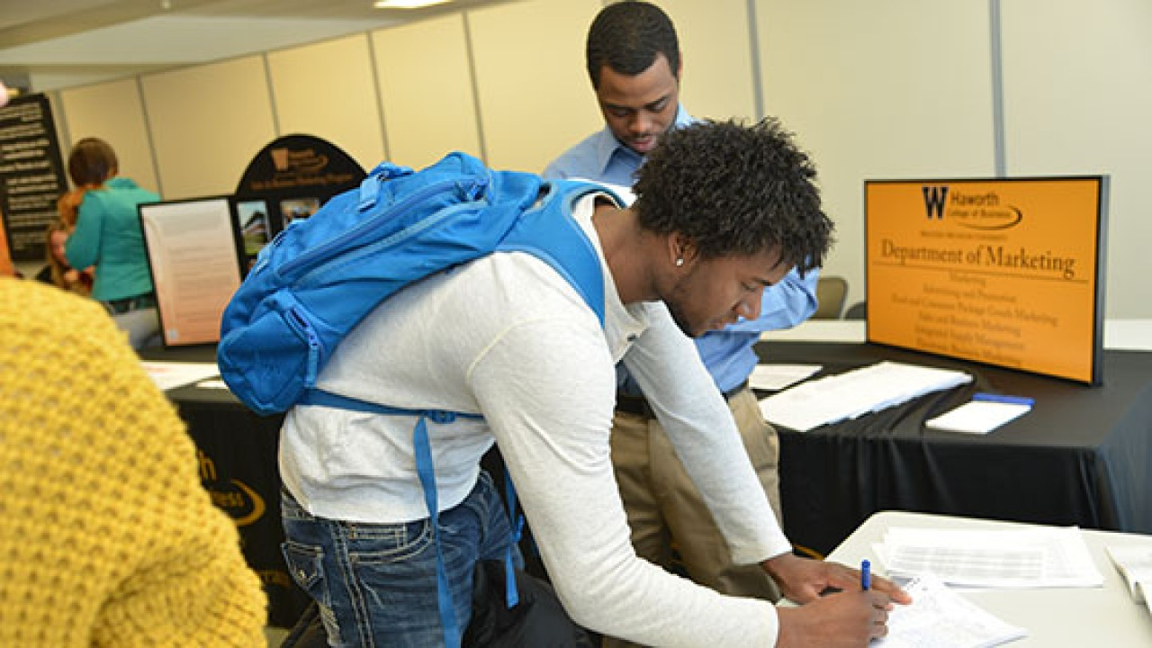 Photo of student registering for event.