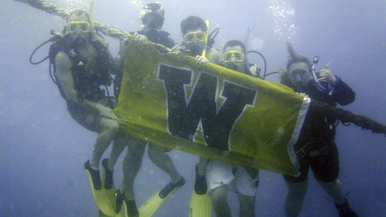 WMU students scuba diving abroad.