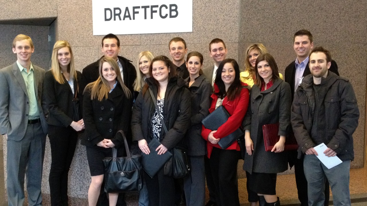 Photo of students in front of DRAFTFCB sign