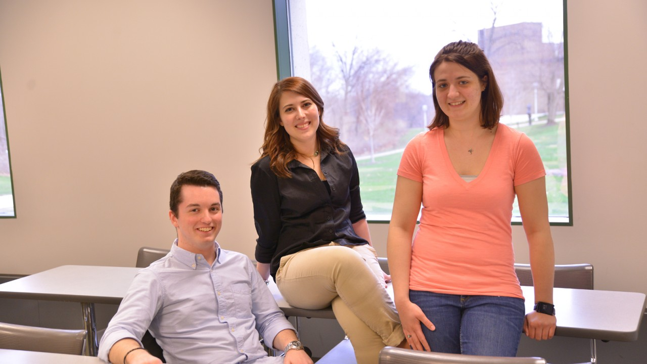 Photo of three students from competition team