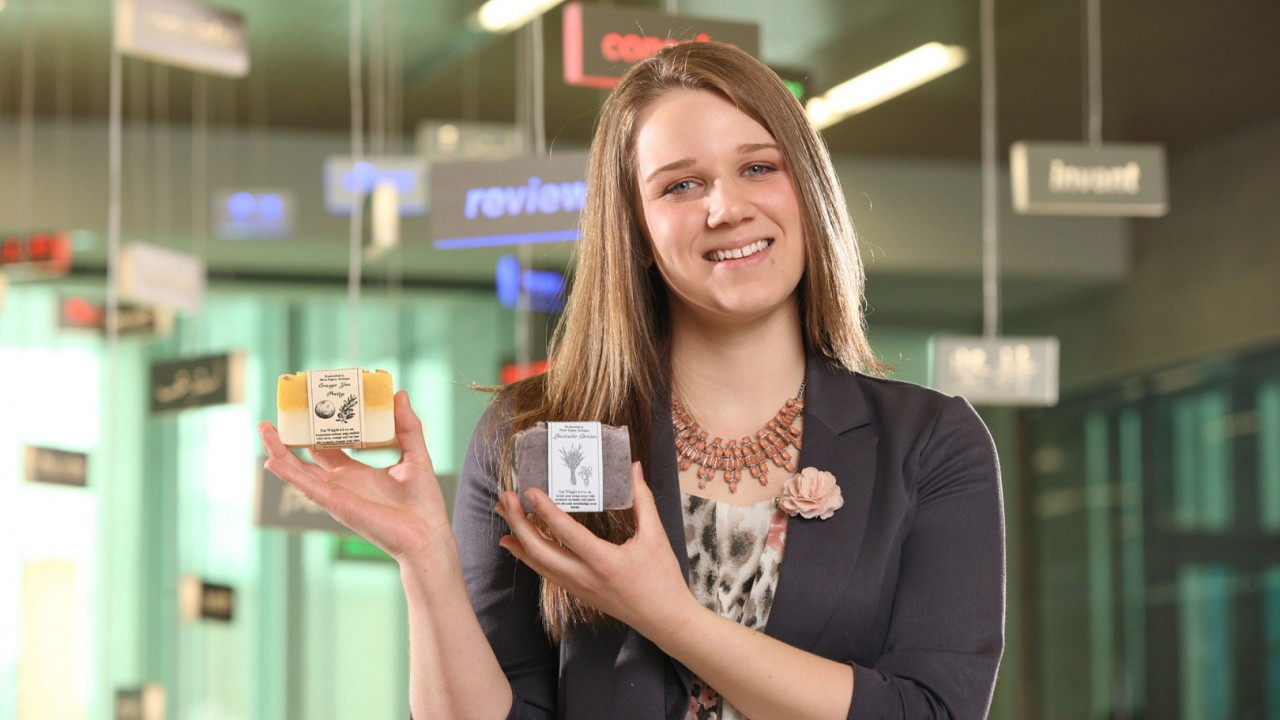 Photo of Megan Delp with scented soaps.