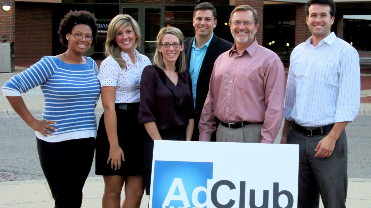 Students with AdClub sign