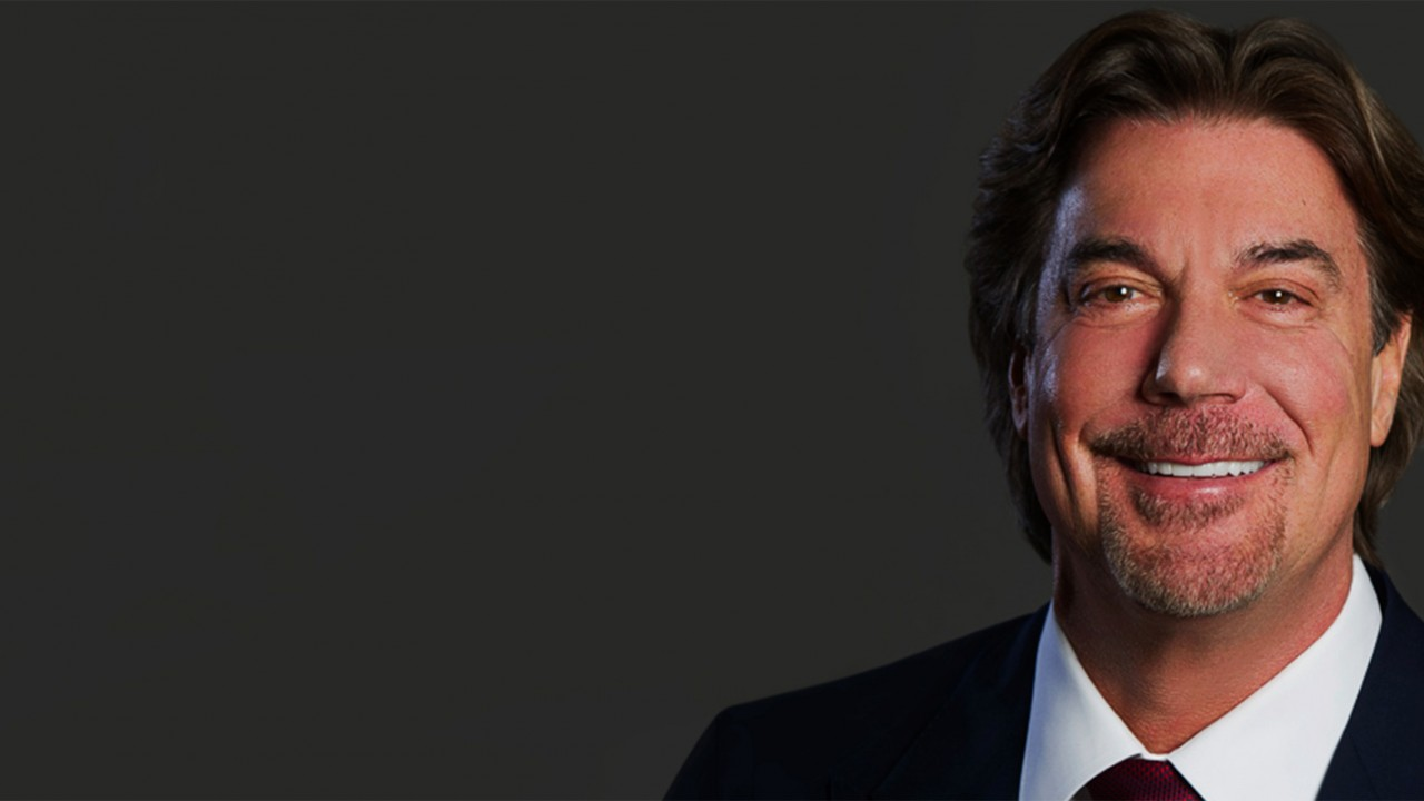 Head shot of Robert Kaiser smiling in professional dress.