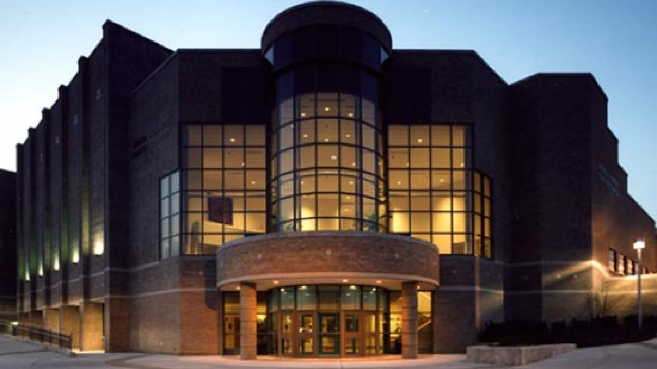 Front of the GIlmore Theatre Complex at night.