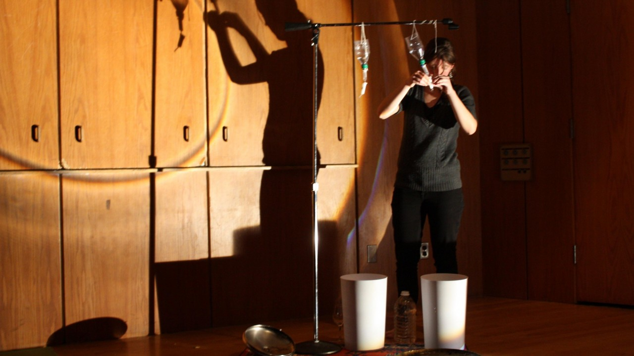Photo of a girl recording dripping sounds.