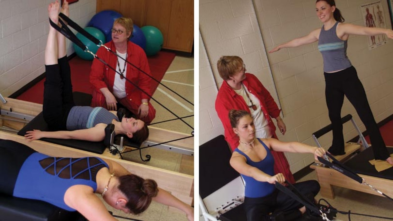 Professor and two students using exercise equipment in the conditioning room.