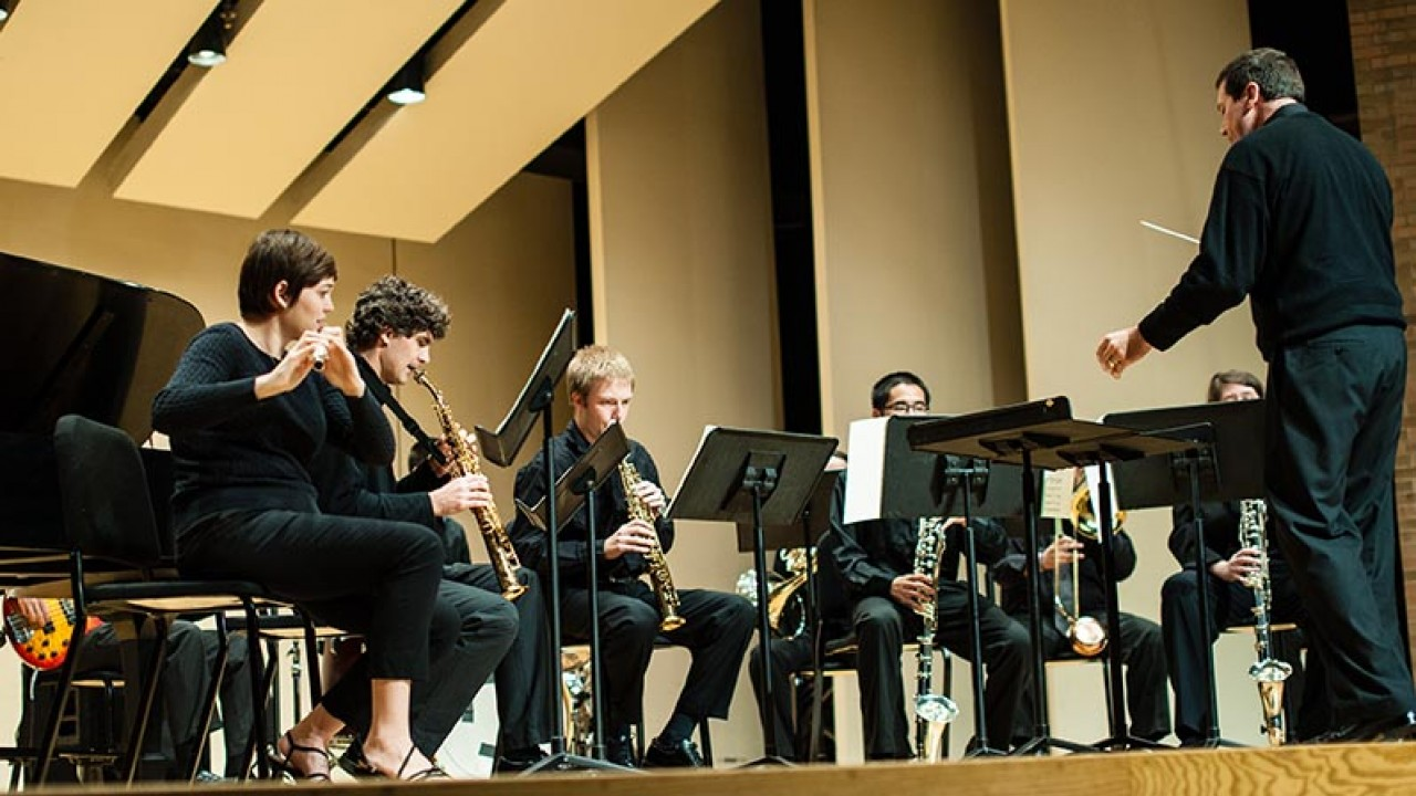 close up image of woodwinds being conducted on the Dalton Center Recital Hall stage