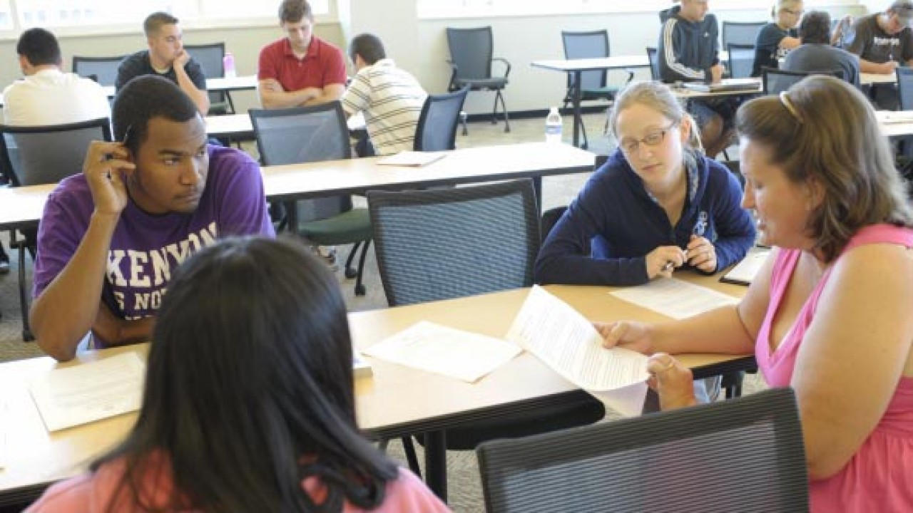 Students sitting at a table working together