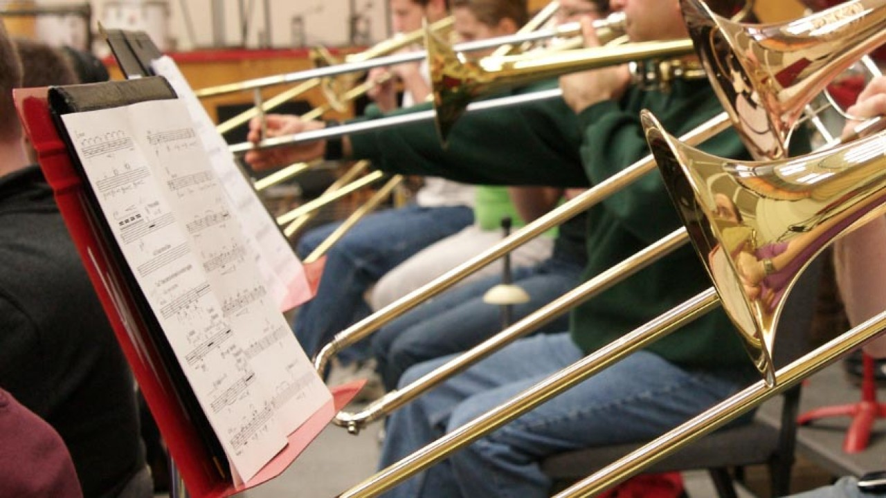close up photo of a row of trombones