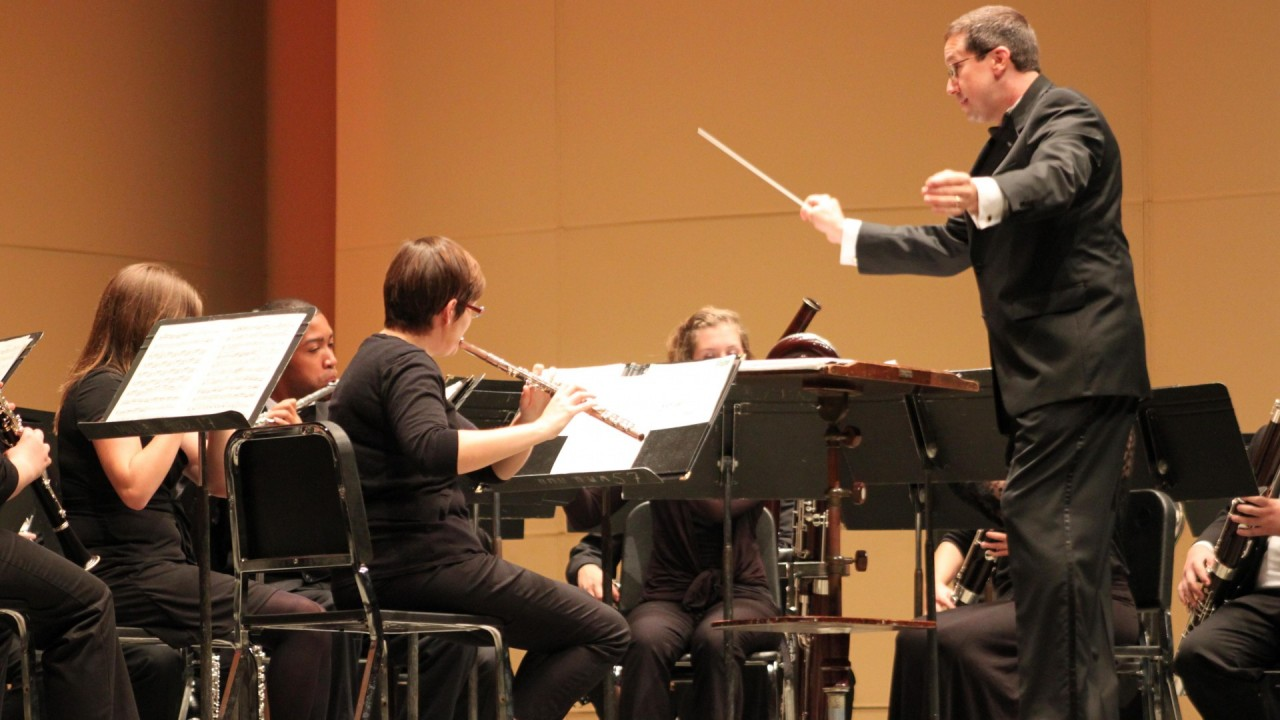 Photo of the Symphonic Band performing on Miller Auditorium's stage with close up of flutes and bassoons