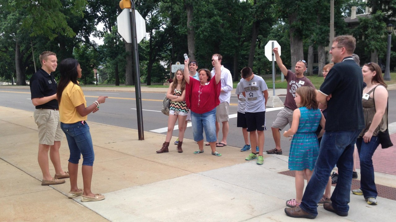 A group of honors college alumni taking the campus tour.