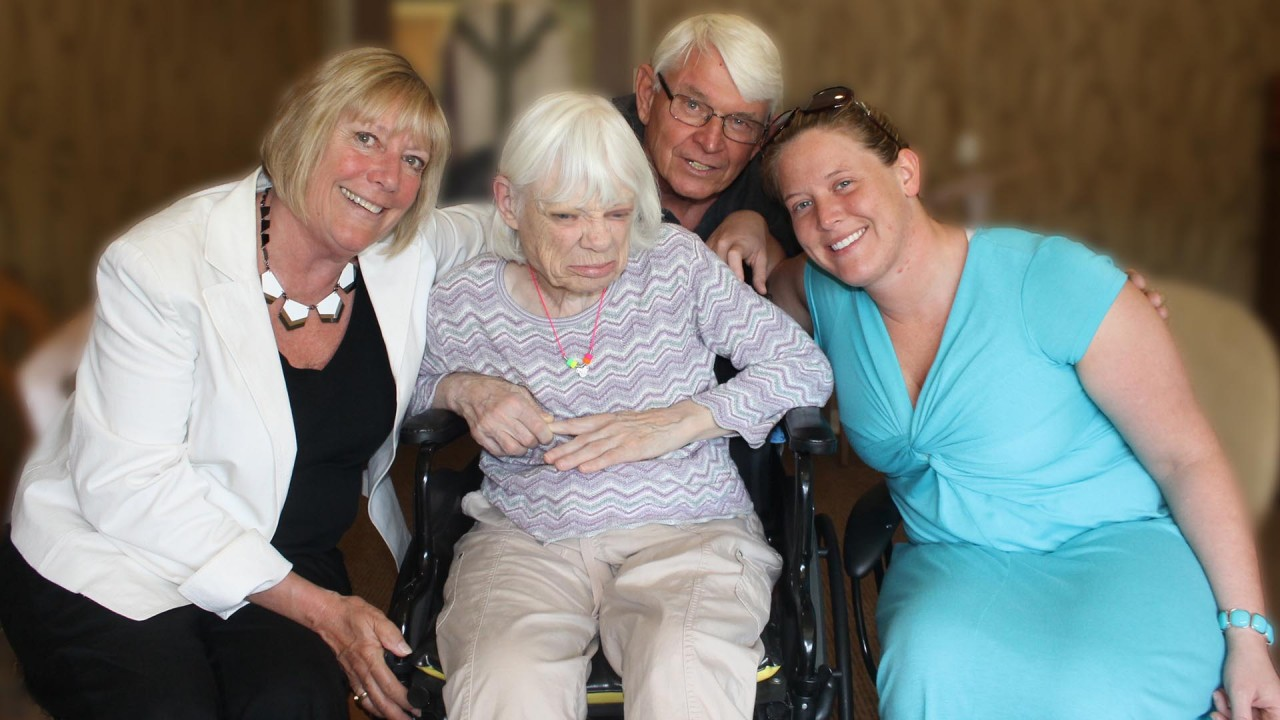 Photo of three women and a man.