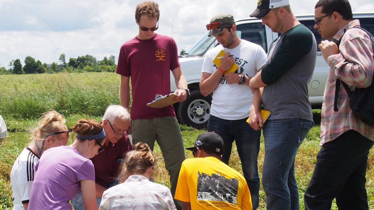 Students doing experiments in the field.