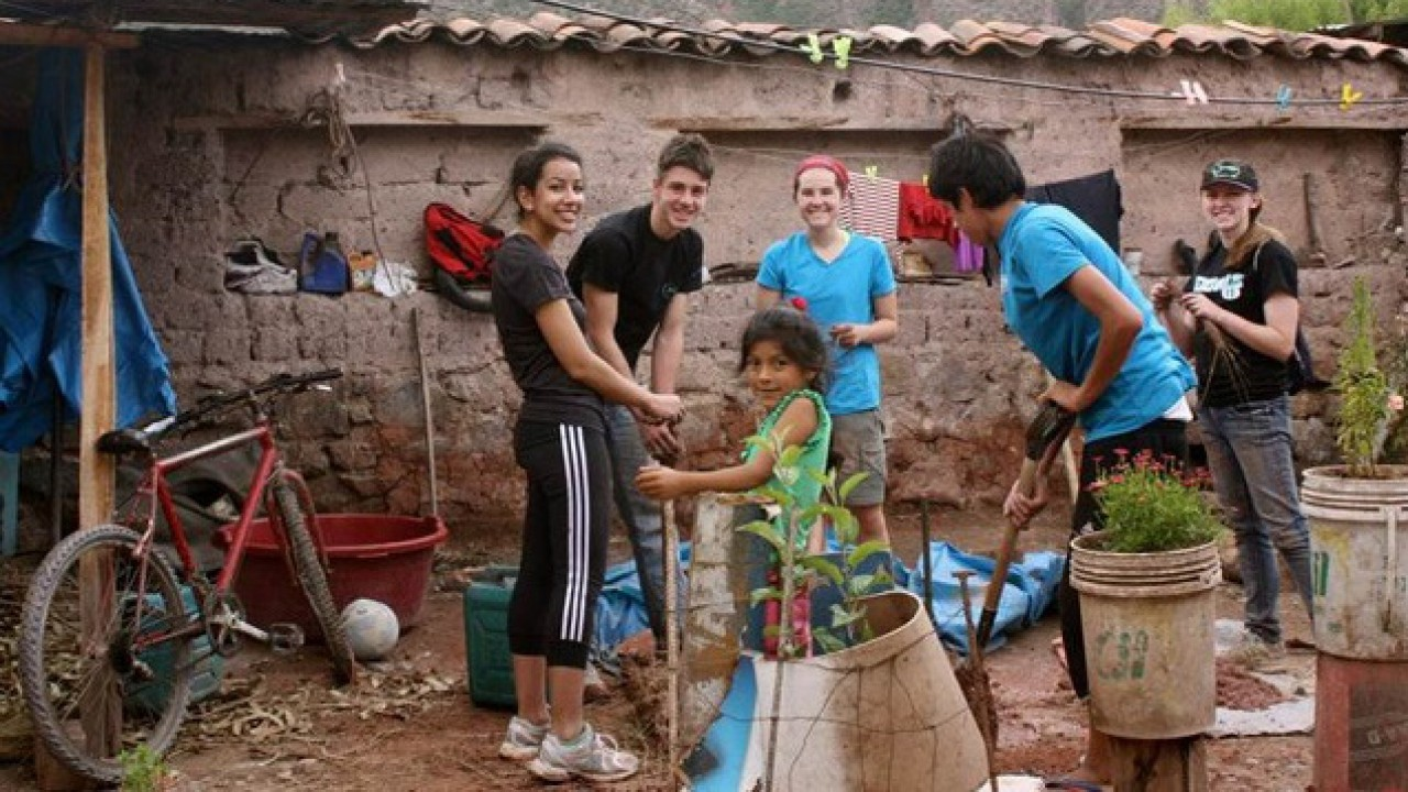Students helping out in an average home in Urubamba, Peru