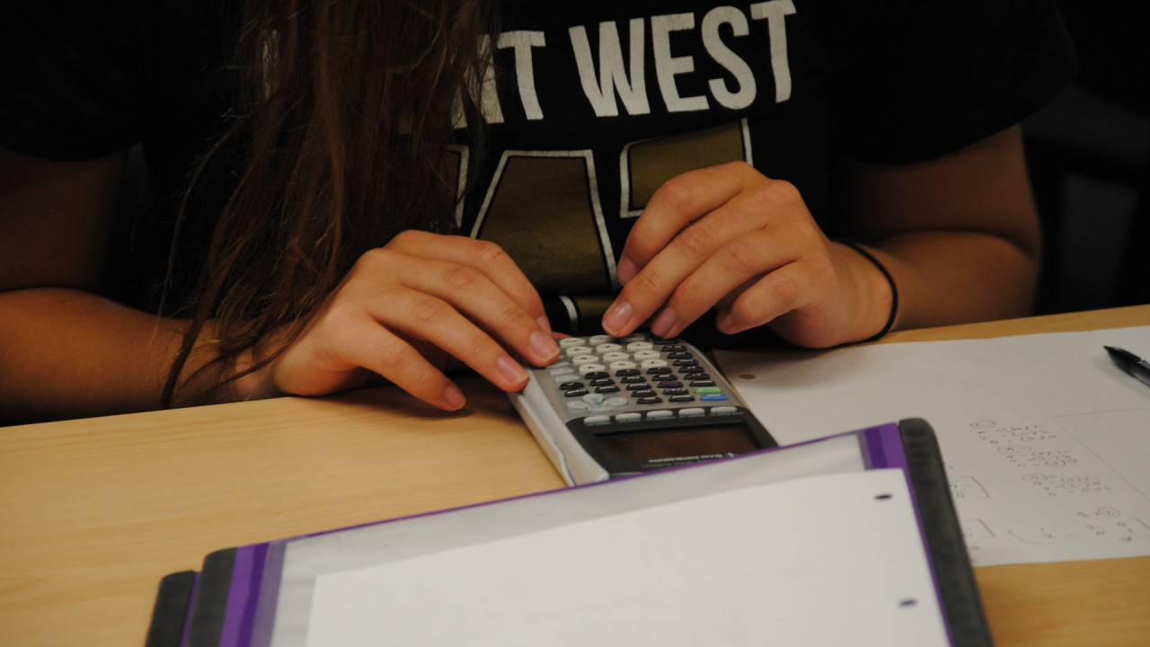 Student using calculator.