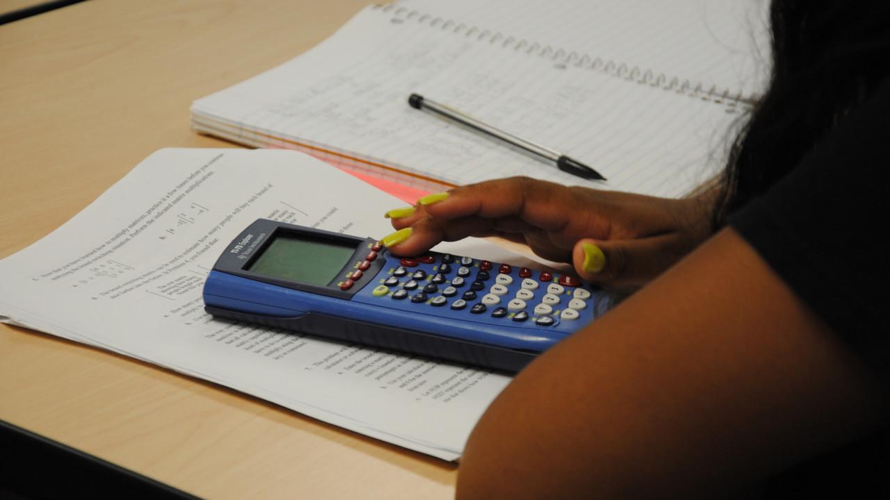 Student using calculator.