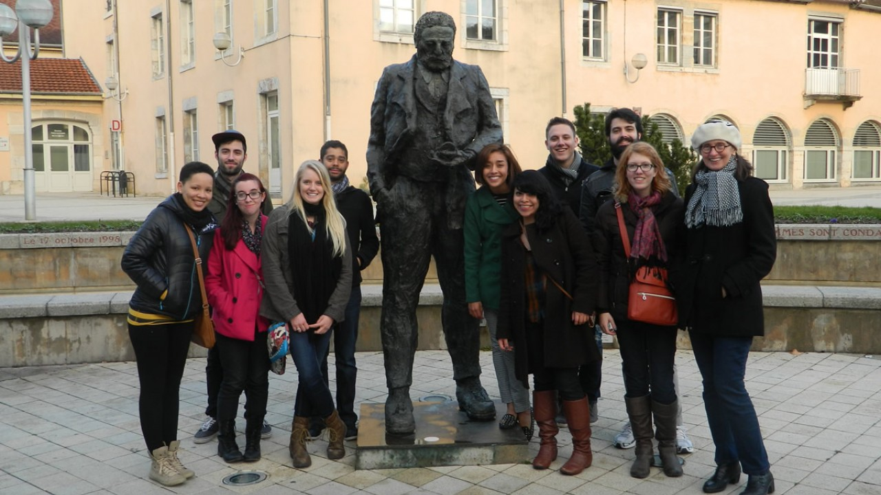 Study abroad students next to statue in Besançon, France.