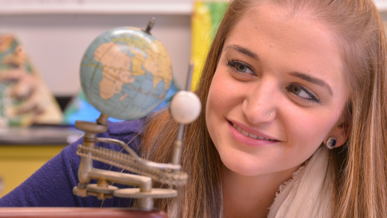 Student and globe