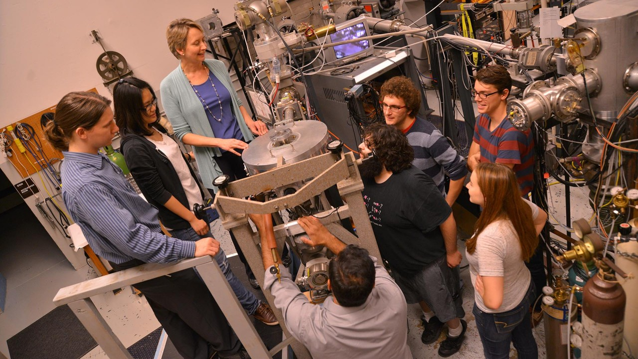 Dr. Paulius and students in the physics laboratory