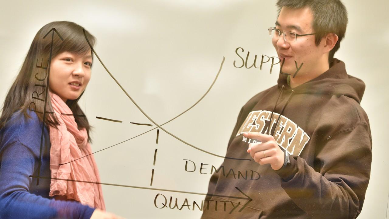 Graduate assistants teaching economics.