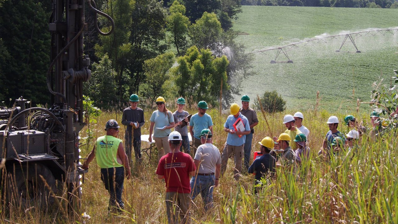 Students in the Hydrogeology Field Course at a hands-on demonstration in the field.