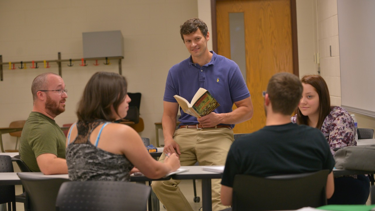 James Cousins reading to a group