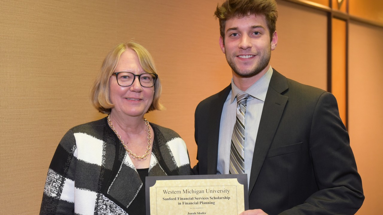 Jonah Shafer receiving an award from Dr. Swisher.