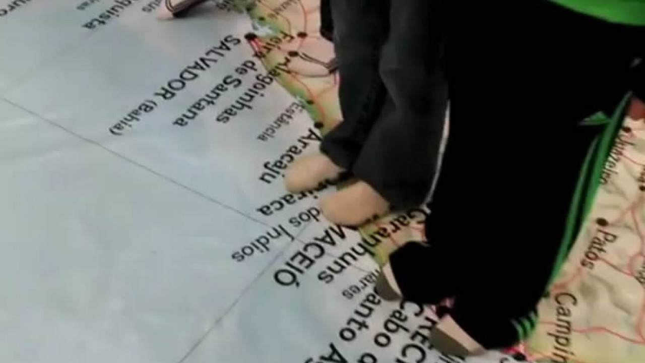Students feet on large map