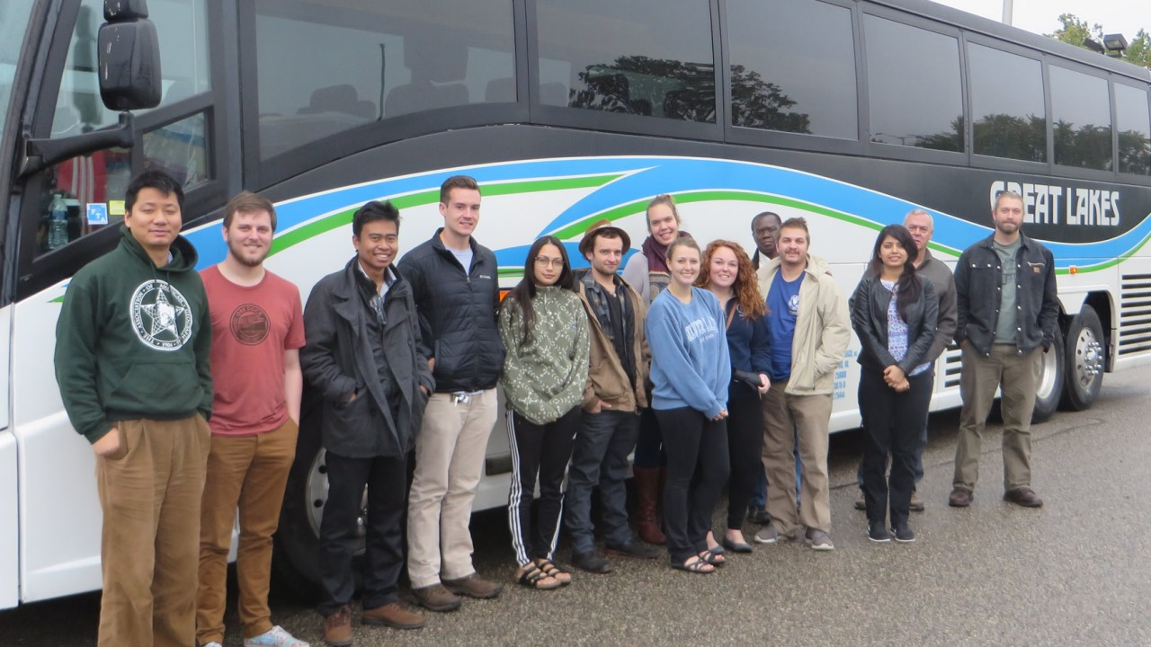 Participants in front of bus