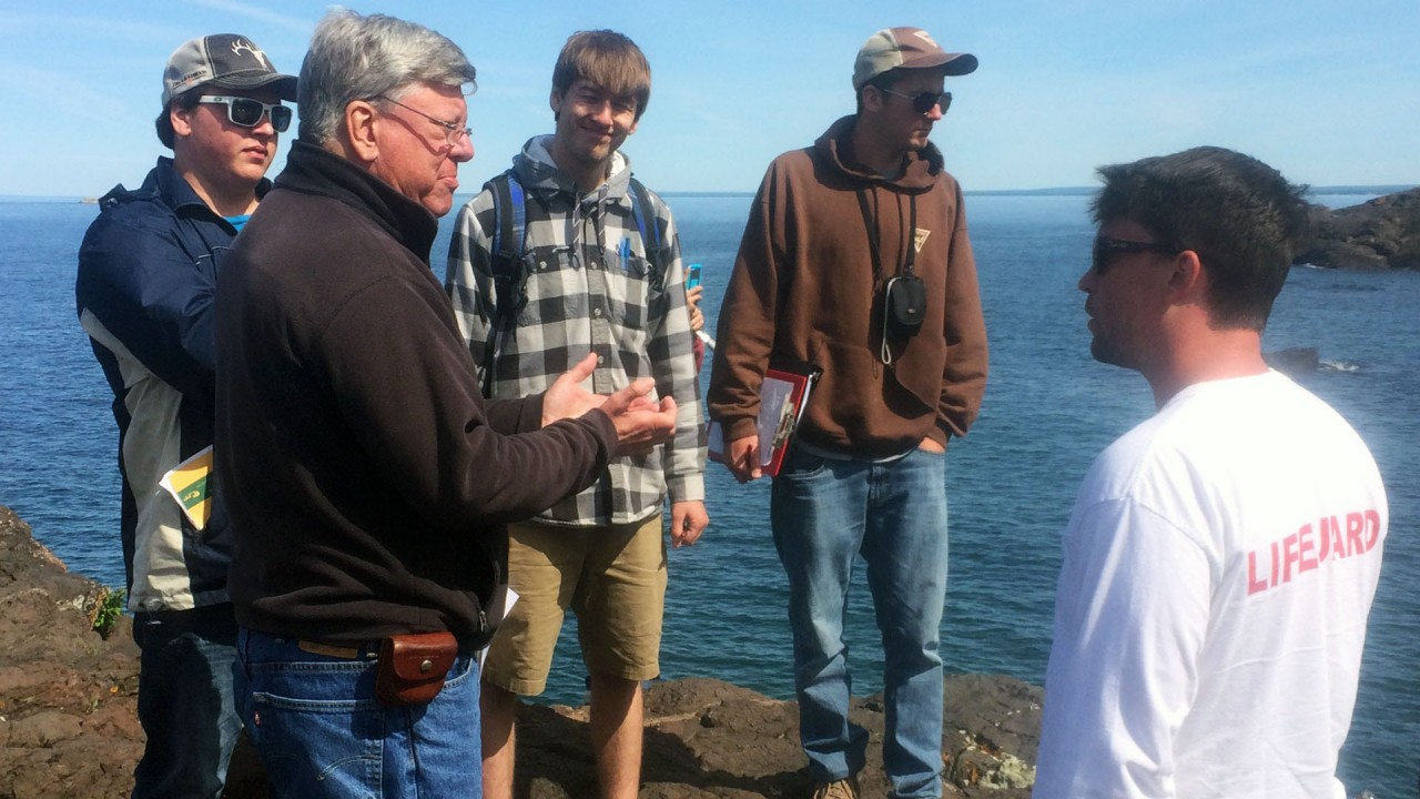 Dr. Gillespie leads a discussion in the field