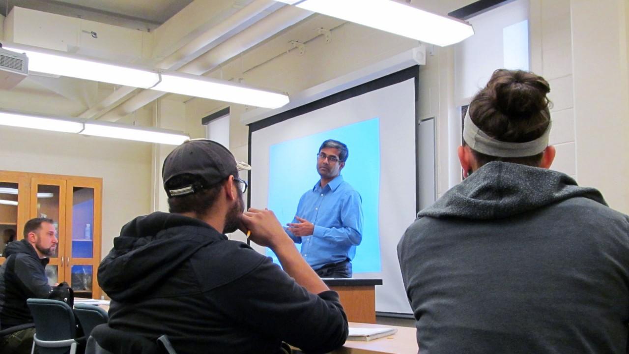 Dr. Joyashish Thakurta leads a class discussion
