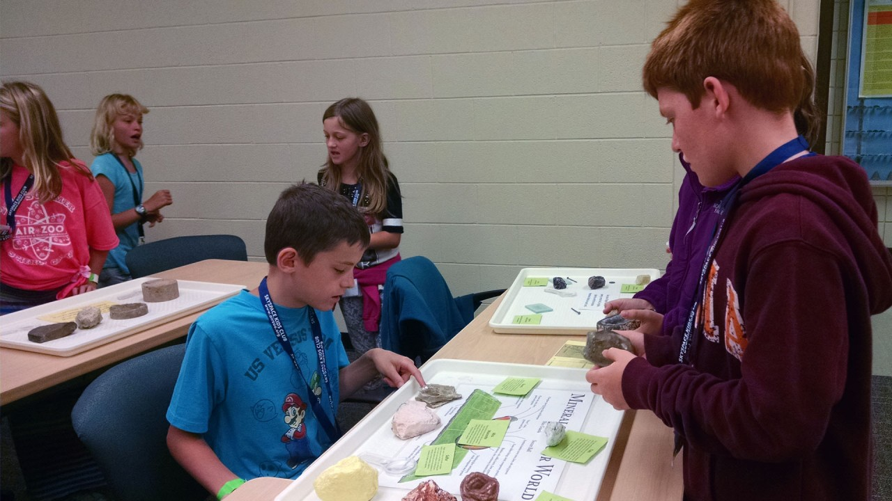 Young students explore mineral samples