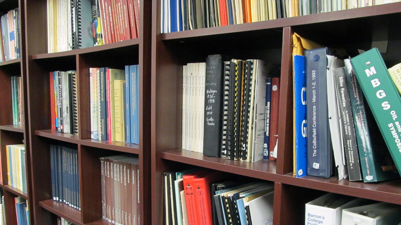 Shelves of reference material in the MGRRE library