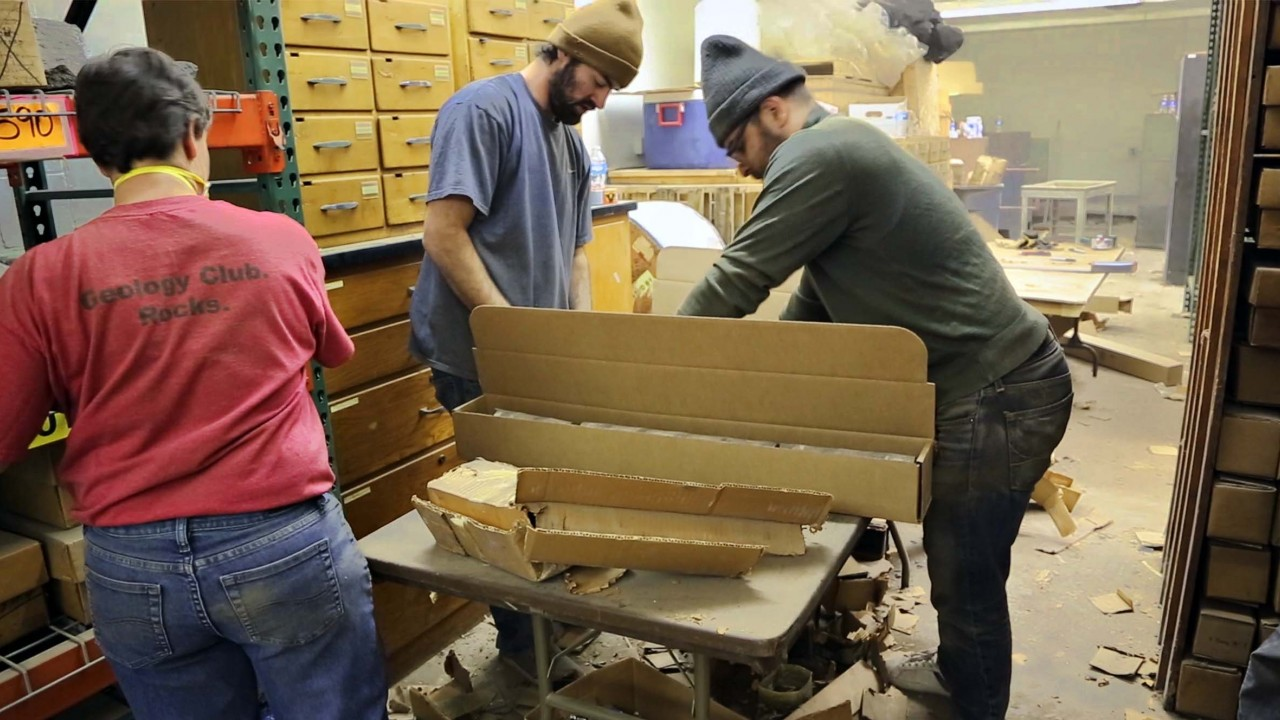 A team of geologists work to re-box damage cores