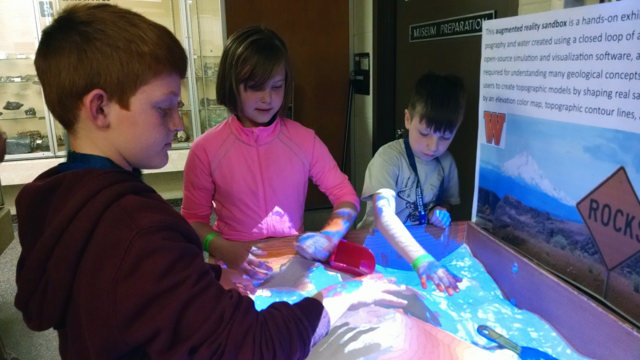 Students explore the augmented reality sandbox