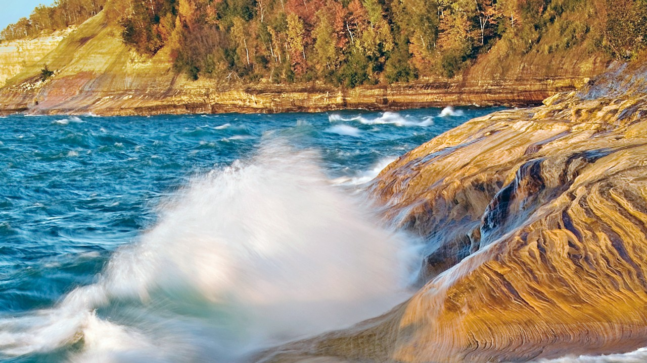 Waves crash against a rock in Lake Michigan