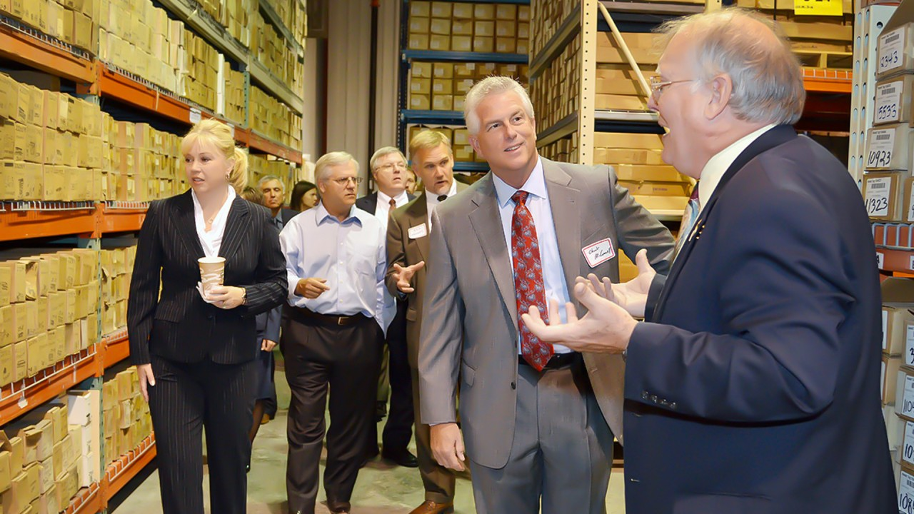 Dr. Harrison guides a tour of industry and govement members through MGRRE