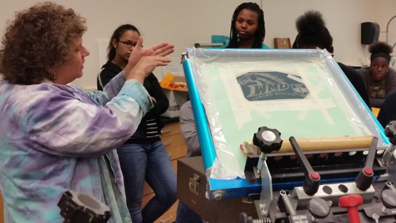 Lois and students in print lab