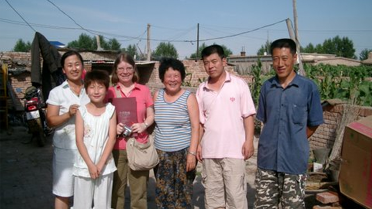 Dr. Ann Veeck visits village in China.