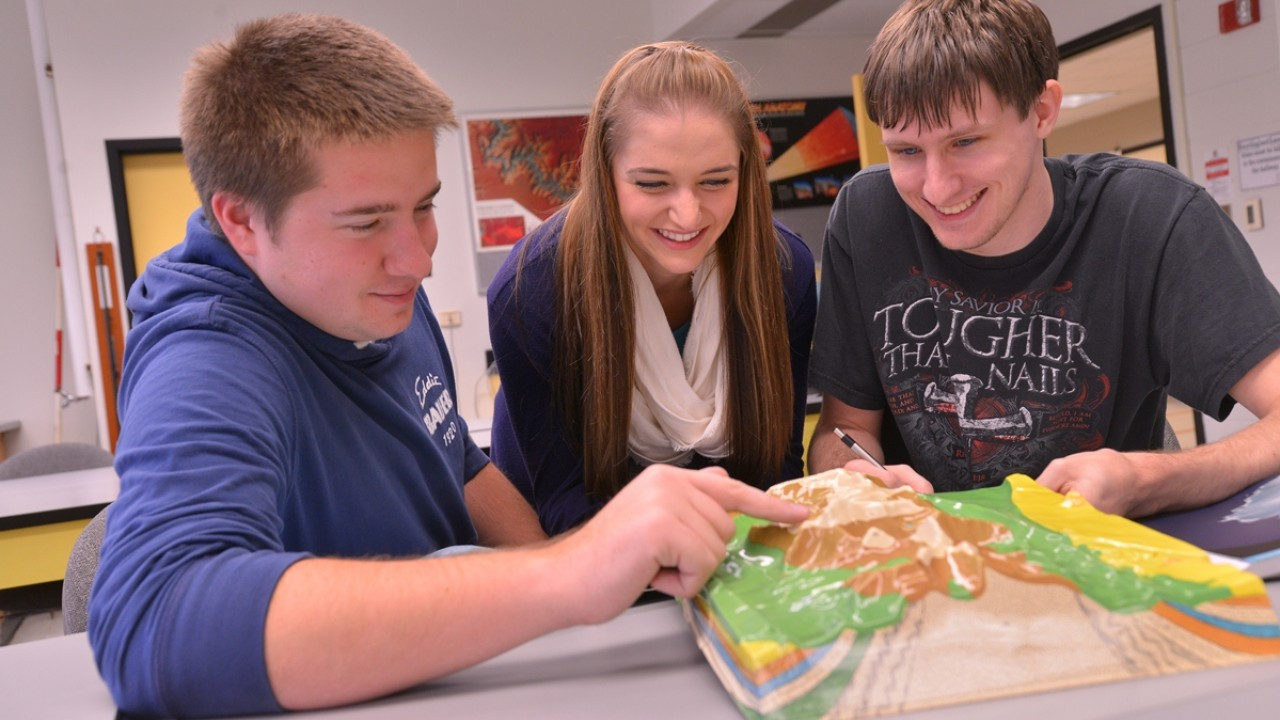 Students examining a relief map