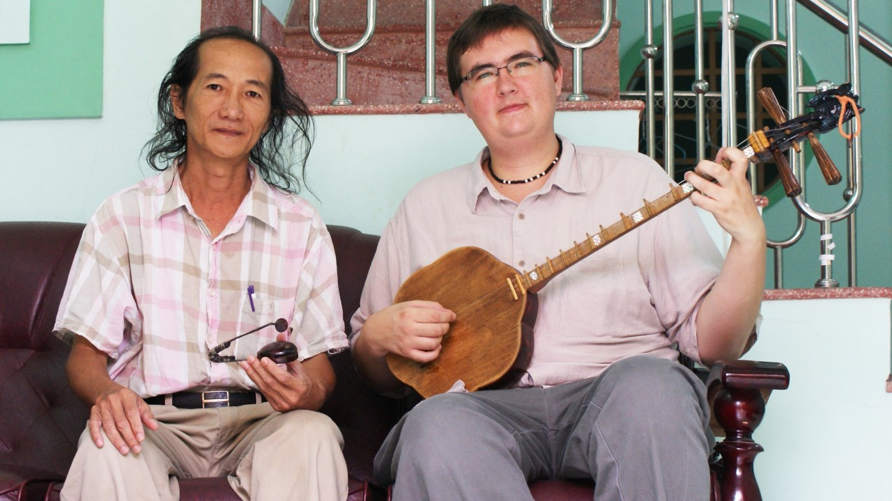 Dr. Alexander Cannon with Vietnamese musician