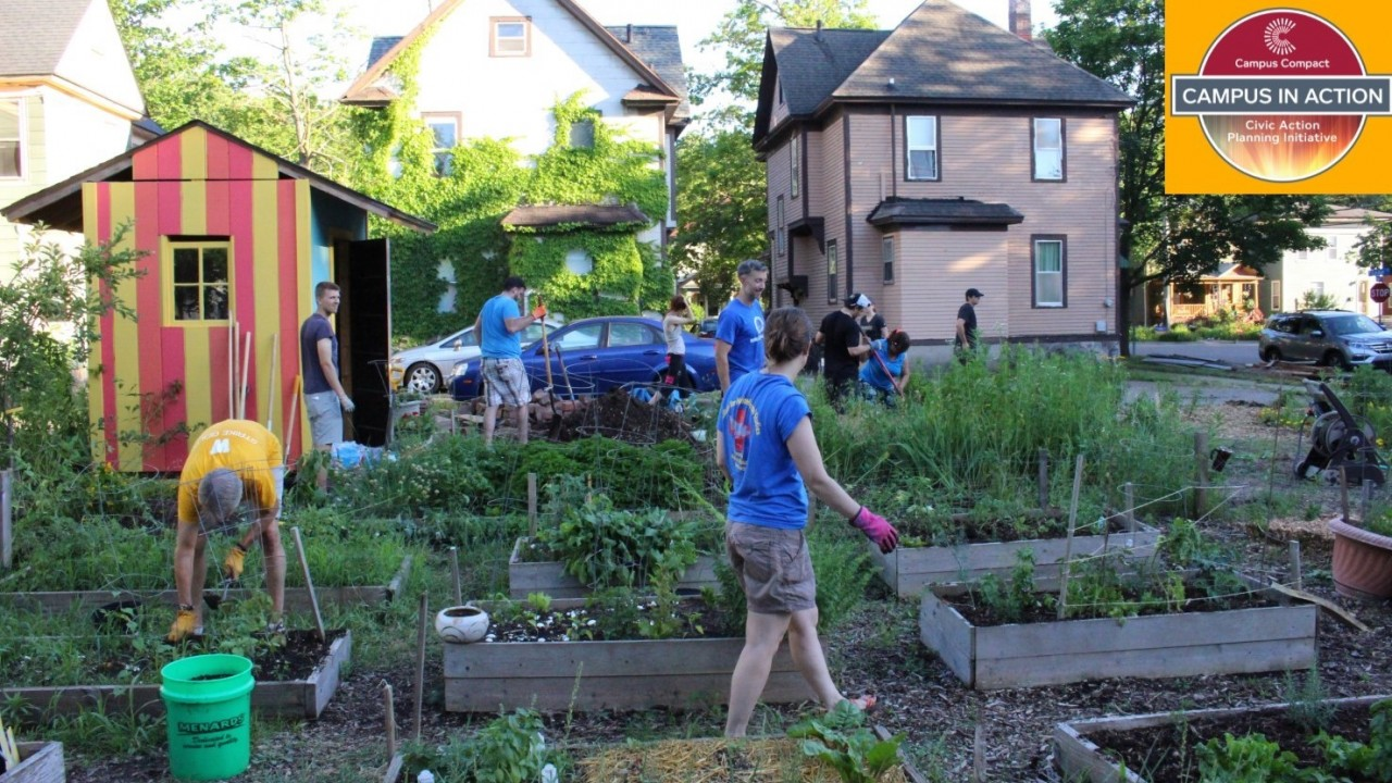 WMU student volunteers helping with neighborhood garden