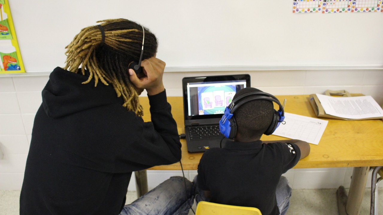 WMU student working with an elementary school student