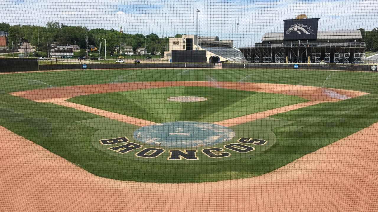 View of the WMU baseball field with the word Broncos around the home base and Waldo Stadium in the background