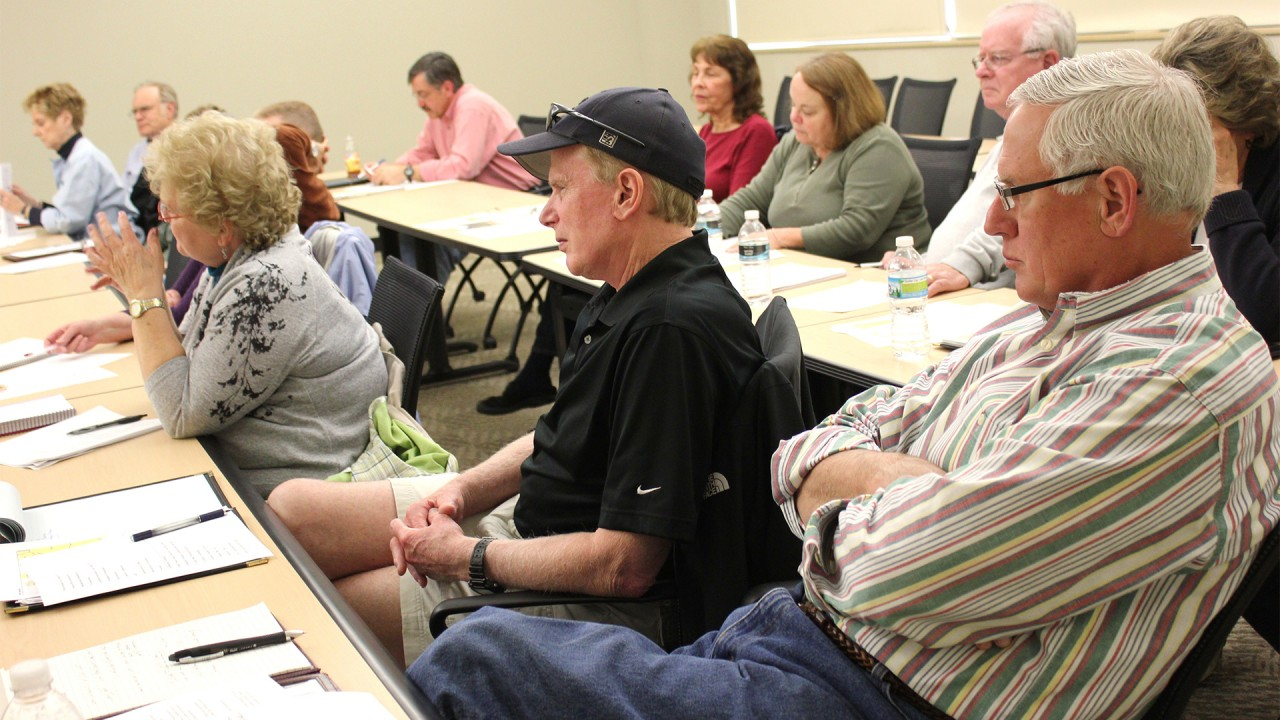 Academy of Lifelong Learning members listening to a lecture