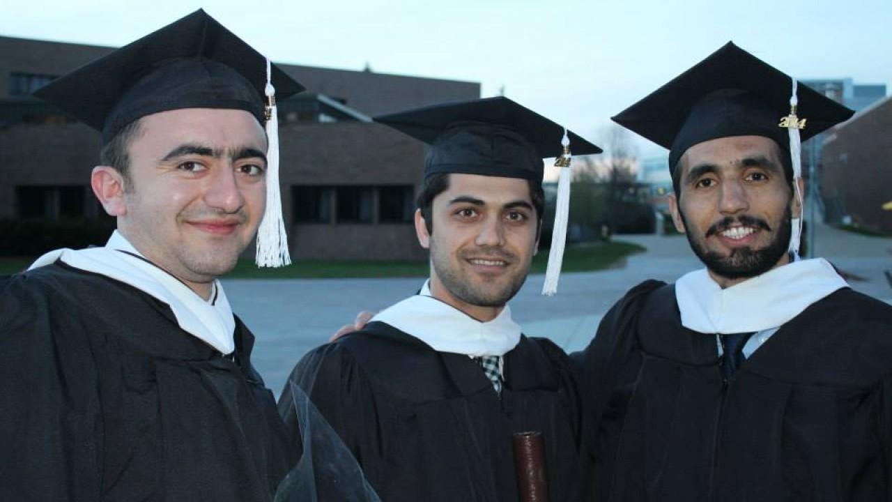 Graduates posing for a photo