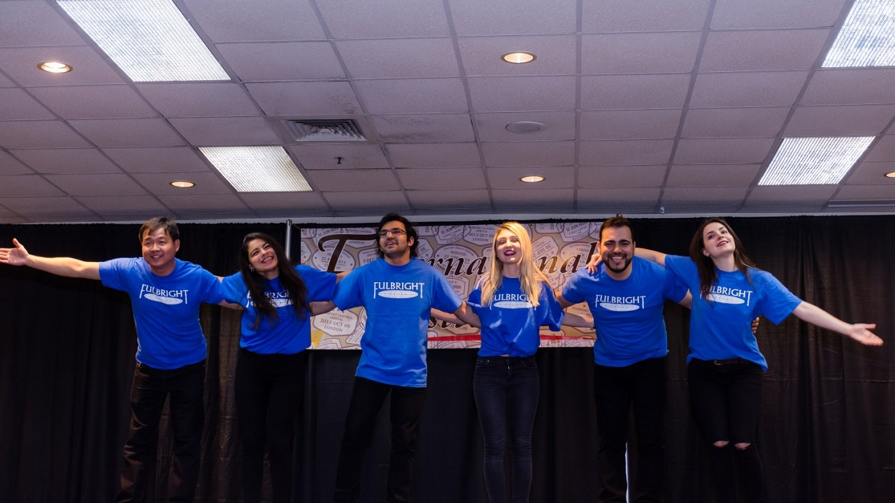 Six Fulbright Fellows bow after their performance at the 2018 International Festival.