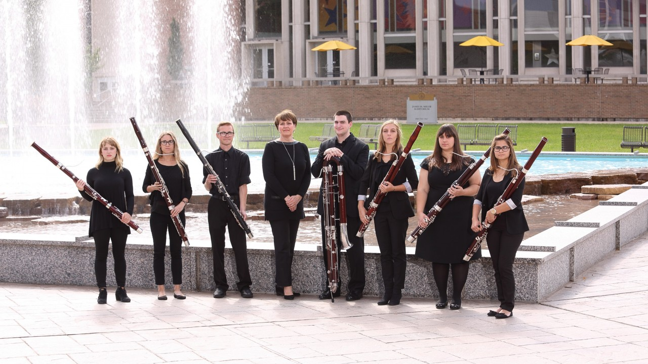 bassoon students posing outside the fountain