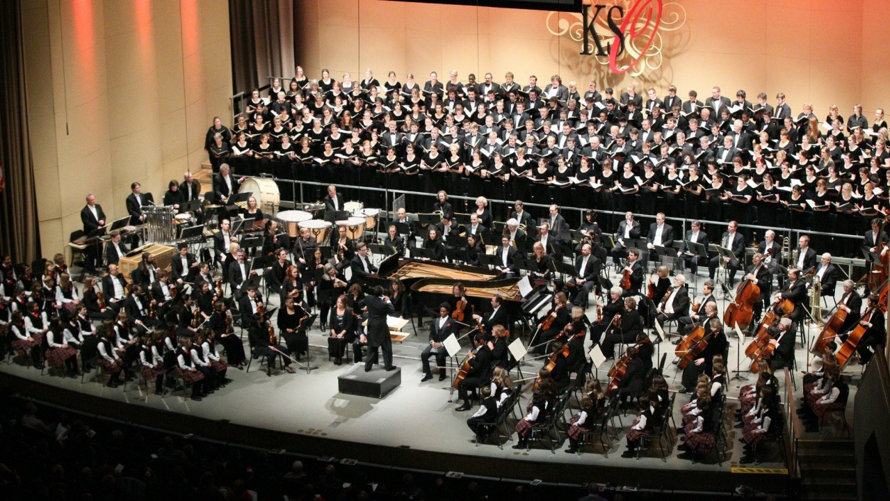 a full choir and orchestra in an auditorium