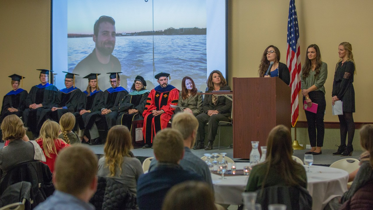 Erin McRae, WMU freshwater science and sustainability student, shares memories about Michael Kandel, the student of the freshwater science and sustainability program who passed away following a tragic accident in Sturgeon Bay, July 20, 2017. McRae, along with recent graduates Alexis Lautner (to the right of McRae) and Paige Harrigan (far right) reflected on time spent with Kandel in the program during Western Michigan University-Traverse City's graduate recognition ceremony for the freshwater science and su